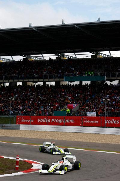 Nurburgring, Germany12th July 2009Rubens Barrichello, Brawn GP BGP001 Mercedes, 6th position, leads Jenson Button, Brawn GP BGP001 Mercedes, 5th position. Action. World Copyright: Charles Coates/LAT Photographicref: Digital Image _26Y0628