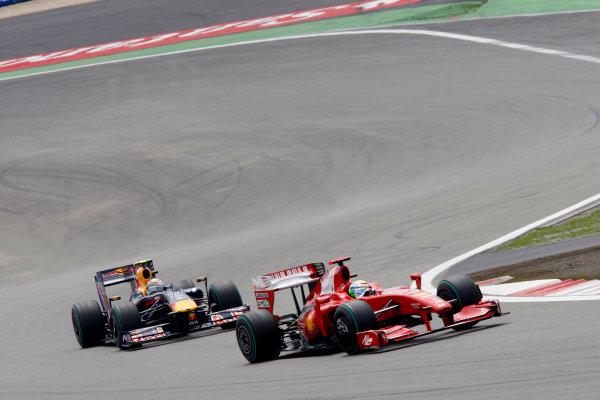 Nurburgring, Germany12th July 2009Felipe Massa, Ferrari F60, 3rd position, leads Sebastian Vettel, Red Bull Racing RB5 Renault, 2nd position. Action. World Copyright: Alastair Staley/LAT Photographicref: Digital Image _O9T9332