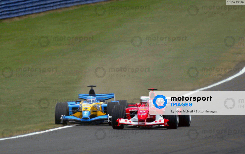 Michael Schumacher (GER) Ferrari F2003-GA runs Fernando Alonso (ESP) Renault R23B onto the grass on the run down to Stowe corner on lap one.Formula One World Championship, Rd11, British Grand Prix, Race Day, Silverstone, England, 20 July 2003.DIGITAL IMAGE