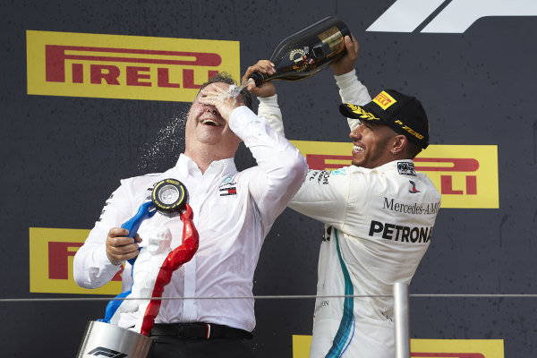 Lewis Hamilton, Mercedes AMG F1, 1st position, pours Champagne aon Ron Meadows, Sporting Director, Mercedes AMG, on the podium.