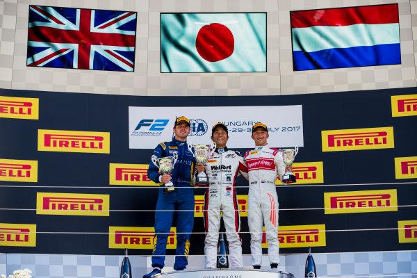 2017 FIA Formula 2 Round 7. Hungaroring, Budapest, Hungary. Sunday 30 July 2017. Oliver Rowland (GBR, DAMS), Nobuharu Matsushita (JPN, ART Grand Prix), Nyck De Vries (NED, Rapax).  Photo: Zak Mauger/FIA Formula 2. ref: Digital Image _54I4951