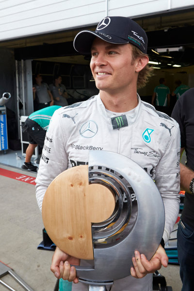 Red Bull Ring, Spielberg, Austria. Sunday 22 June 2014. Nico Rosberg, Mercedes AMG, 1st Position, with his trophy. World Copyright: Steve Etherington/LAT Photographic. ref: Digital Image SNE26981copy