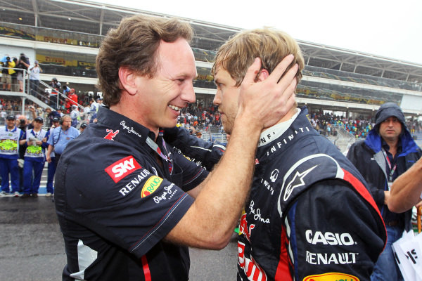 Christian Horner (GBR) Red Bull Racing Team Principal and World Champion Sebastian Vettel (GER) Red Bull Racing celebrate in parc ferme. Formula One World Championship, Rd20 Brazilian Grand Prix, Race, Sao Paulo, Brazil, 25 November 2012.