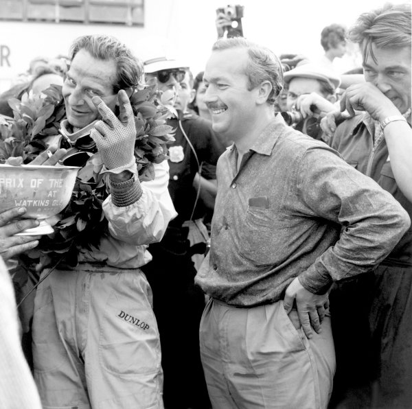1961 United States Grand Prix.Watkins Glen, USA. 8 October 1961.Innes Ireland (Lotus 21-Climax) celebrates 1st position with team owner Colin Chapman. Ref-10112.World Copyright: LAT Photographic