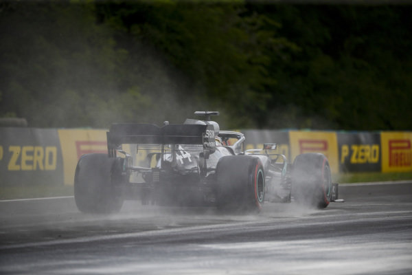 Lewis Hamilton, Mercedes AMG F1 W10, kicks up cement dust which was laid down to cover a heavy oil spill in the F2 race prior to the session