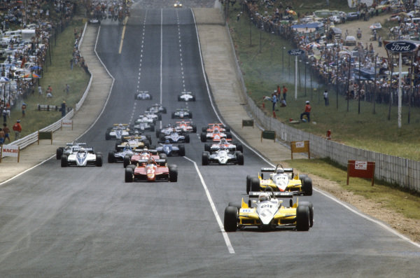 René Arnoux, Renault RE30B, leads Alain Prost, Renault RE30B, Gilles Villeneuve, Ferrari 126C2, Didier Pironi, Ferrari 126C2, Riccardo Patrese, Brabham BT50 BMW, and Keke Rosberg, Williams FW07D Ford, into the first corner.