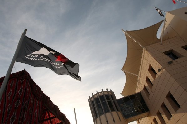 Paddock buildings and an F1 flag. Formula One World Championship, Rd 1, Bahrain Grand Prix, Preparations, Bahrain International Circuit, Sakhir, Bahrain, Thursday 11 March 2010. BEST IMAGE
