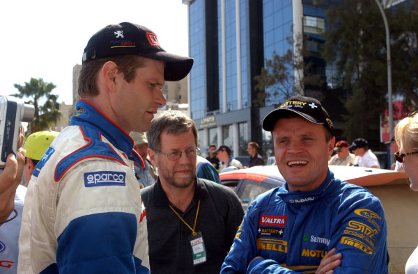World Rally Championship, Cyprus Rally, April 18-21, 2002.Marcus Gronholm and Tommi Makinen discuss Stage 12 which suffered very heavy rain during the stage.Photo: Ralph Hardwick/LAT