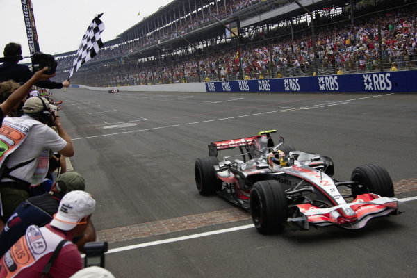 Lewis Hamilton, McLaren MP4-22 Mercedes takes the chequered flag over the yard of bricks for his second consecutive victory.