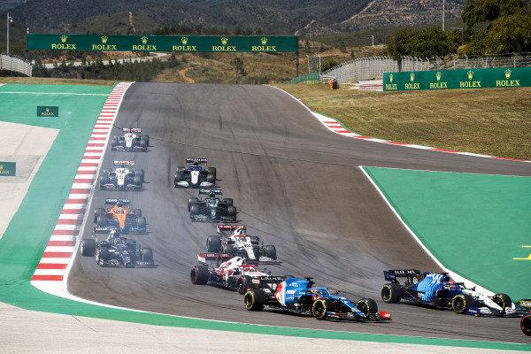 George Russell, Williams FW43B, leads Fernando Alonso, Alpine A521, Kimi Raikkonen, Alfa Romeo Racing C41, Antonio Giovinazzi, Alfa Romeo Racing C41, Yuki Tsunoda, AlphaTauri AT02, and the remainder of the field at the start
