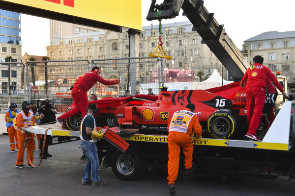Crashed car of Charles Leclerc, Ferrari SF90 is retuned to Ferrari mechanics on the back of a low loader
