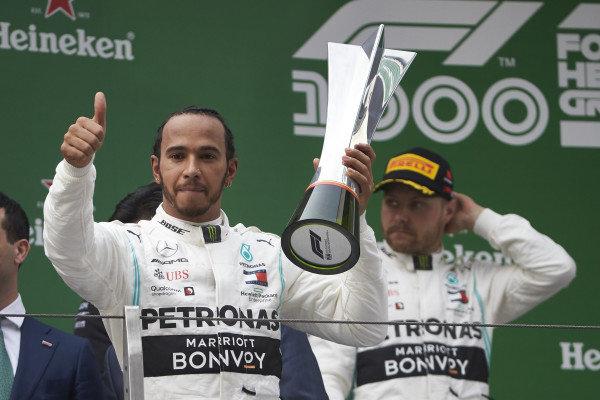 Valtteri Bottas, Mercedes AMG F1, 2nd position, and Lewis Hamilton, Mercedes AMG F1, 1st position, on the podium