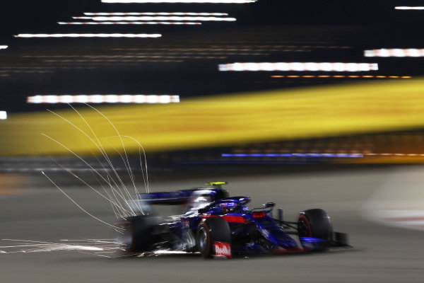Sparks fly from the car of Alexander Albon, Toro Rosso STR14