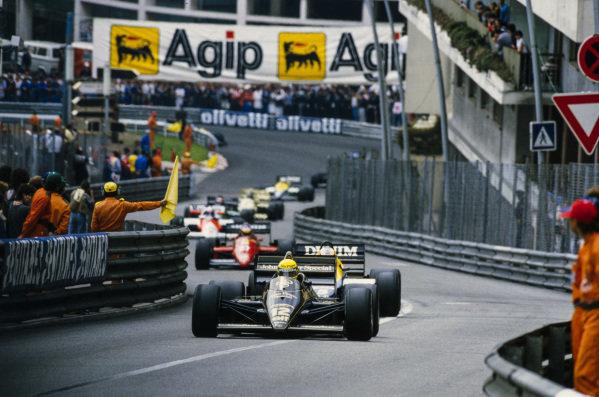Ayrton Senna, Lotus 97T Renault, leads Nigel Mansell, Williams FW10 Honda, Michele Alboreto, Ferrari 156/85, and Alain Prost, McLaren MP4-2B TAG.