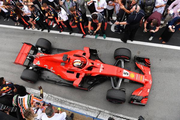 Race winner Sebastian Vettel (GER) Ferrari SF-71H arrives in parc ferme .