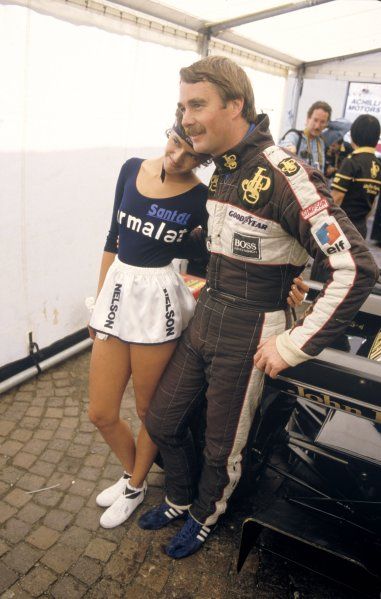 1984 Dutch Grand Prix.Zandvoort, Holland 24-26 August 1984.Nigel Mansell (Lotus 95T Renault) 3rd position, with a  Nelson Piquet, sponsored grid girl, portrait.World Copyright - LAT PhotographicRef: 35mm Colour Transparency.