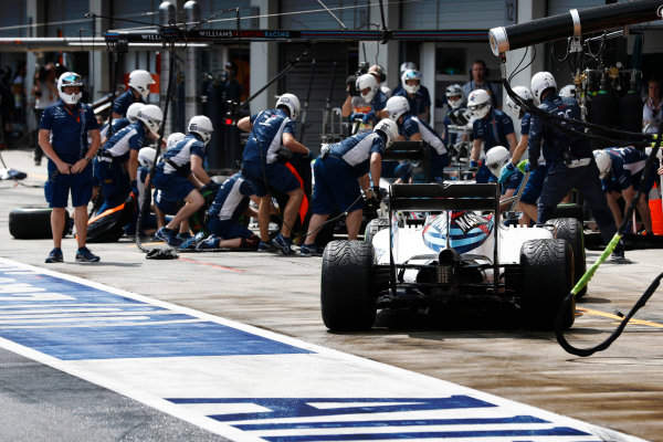 Red Bull Ring, Spielberg, Austria. Saturday 02 July 2016. Valtteri Bottas, Williams FW38 Mercedes, waits behind Felipe Massa, Williams FW38 Mercedes, in the pits to change tyres. World Copyright: Glenn Dunbar/LAT Photographic ref: Digital Image _V2I2832