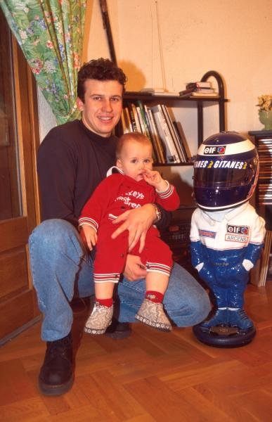 Olivier Panis at home with his baby Formula One Drivers At Home.