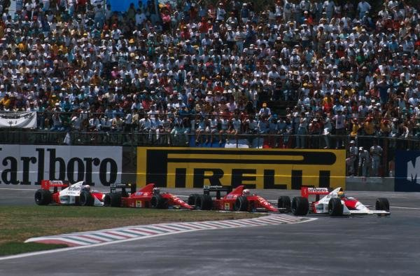 Winner Ayrton Senna (BRA) McLaren MP4/5 leads the pack away at the start Mexican GP, Mexico City, 28 May 1989