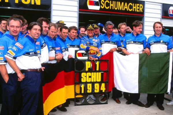 Michael Schumacher (GER) celebrates his World Championship with the Benetton Team and Michael Jakeman (GBR) (far right) FIA Formula One World Championship, Rd16, Australian Grand Prix, Adelaide, Australia, 13 November 1994.