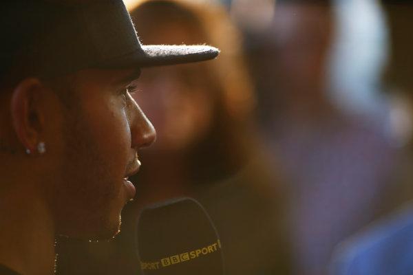 Sochi Autodrom, Sochi, Russia. Sunday 12 October 2014. Lewis Hamilton, Mercedes AMG, speaks to BBC Sport. World Copyright: Andy Hone/LAT Photographic. ref: Digital Image _ONZ8019