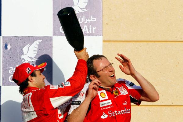 Bahrain International Circuit, Sakhir, Bahrain14th March 2010Felipe Massa, Ferrari F10, 2nd position, drenches Stefano Domenicali, Sporting Director, Ferrari, with Waard on the podium. Portrait. Podium. World Copyright: Glenn Dunbar/LAT Photographicref: Digital Image _G7C1031
