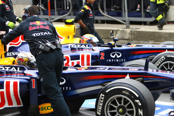Nurburgring, Germany.22nd July 2011Sebastian Vettel, Red Bull Racing RB7 Renault, and Mark Webber, Red Bull Racing RB7 Renault, return to the garage. Portrait. Technical. World Copyright: Andy Hone/LAT Photographicref: Digital Image CSP11022