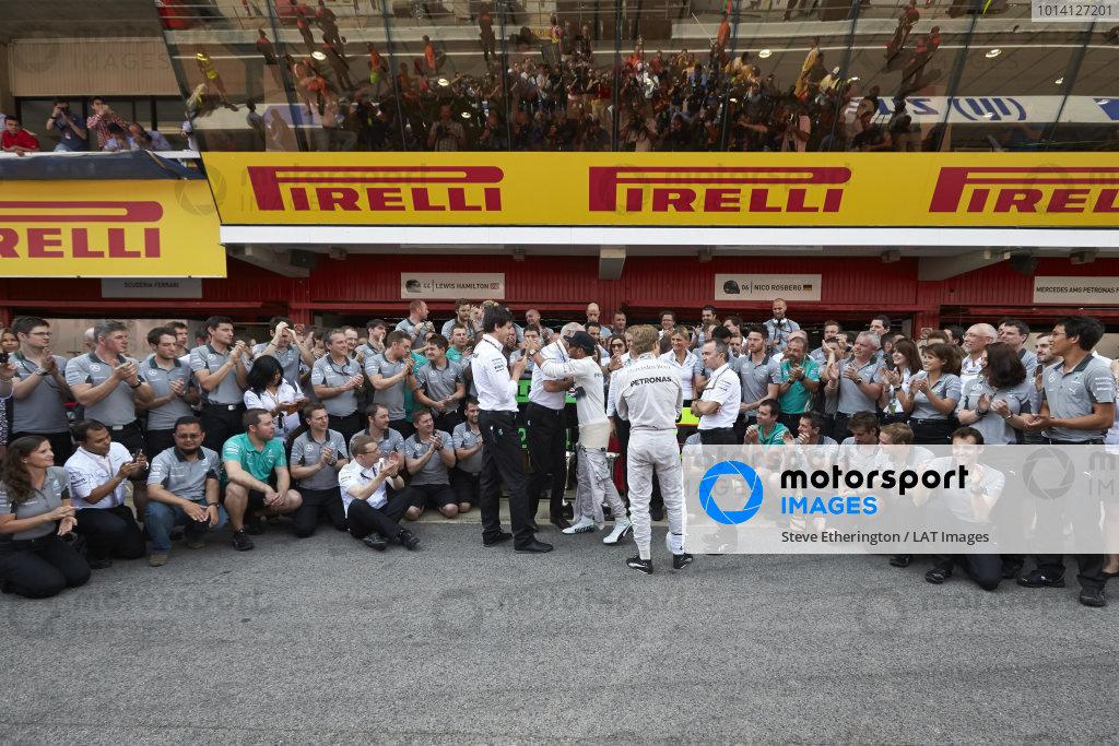 Circuit de Catalunya, Barcelona, Spain. Sunday 11 May 2014. Lewis Hamilton, Mercedes AMG, 1st Position, Nico Rosberg, Mercedes AMG, 2nd Position, and the Mercedes AMG team celebrate a perfect weekend. World Copyright: Steve EtheringtonLAT Photographic. ref: Digital Image SNE25389 copy