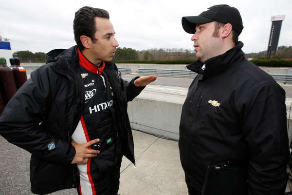 17-18  March, 2014, Birmingham, Alabama, USA Helio Castroneves and a Chevrolet engineer © 2014, Michael L. Levitt LAT Photo USA