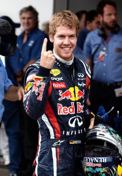 Interlagos, Sao Paulo, Brazil. 26th November 2011. Sebastian Vettel, Red Bull Racing RB7 Renault, celebrates pole in Parc Ferme. Portrait. Helmets.  World Copyright: Steve Etherington/LAT Photographic ref: Digital Image SNE27499