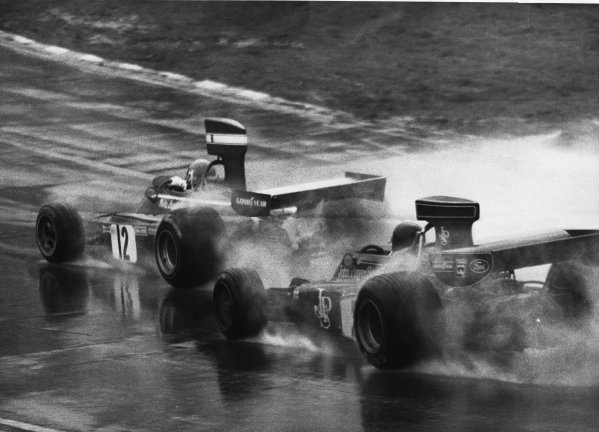 Brands Hatch, England. 17th March 1974.Niki Lauda (Ferrari 312B3), 2nd position leads Jacky Ickx (Lotus 72-Cosworth), 1st position, in the soaking rain, action. World Copyright: LAT Photographic.Ref:  B/WPRINT.