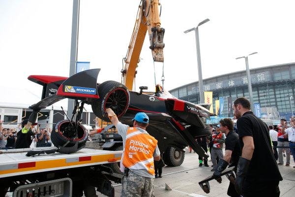 FIA Formula E -  Race Beijing E-Prix, China Saturday 13 September 2014. The damaged car of Nick Heidfeld (Venturi) is returned to the pits after his crash with Nicolas Prost (eDAMS) at the end of the race. Photo: Glenn Dunbar/LAT/ Formula E ref: Digital Image _W2Q2395