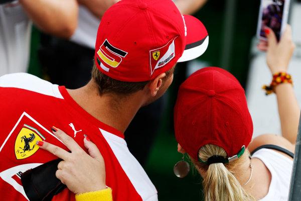 Hungaroring, Budapest, Hungary. Thursday 23 July 2015. Sebastian Vettel, Ferrari, with a fan. World Copyright: Charles Coates/LAT Photographic ref: Digital Image _J5R0799