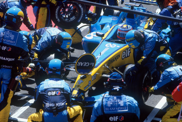 2004 French Grand PrixMagny-Cours, France. 2nd - 4th JulyFernando Alonso, Renault R24 takes a pitstop during the race. Action. World Copyright: LAT PhotographicRef:35mm Image A18