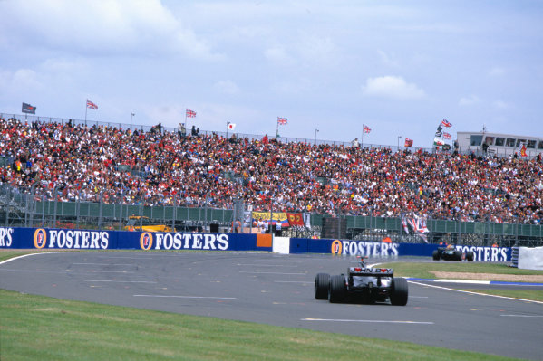 2004 British Grand PrixSilverstone England. 9th - 11th July.Minardi ran a livery with no sponsors as a mark of respect to Minardi sporting director John Walton who died shortly before the grand prix. Action. World Copyright:PICME/LAT Photographic Ref:35mm image A07