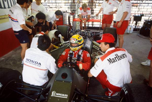Jacarepagua, Rio de Janeiro, Brazil.1-3 April 1988.Ayrton Senna (McLaren MP4/4 Honda), in conversation with Jo Ramirez, portrait. World Copyright: LAT Photographic.Ref:  88BRA31