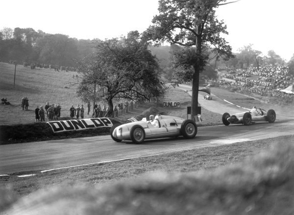 1938 Donington Grand Prix. Donington Park, Great Britain. 22 October 1938. Hermann Muller, Auto Union D, 4th position, leads Dick Seaman, Mercedes-Benz W154, 3rd position, action. World Copyright: LAT Photographic Ref: C16138