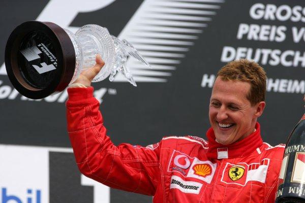 2006 German Grand Prix - Sunday Race Hockenheim, Germany. 27th - 30th July. Michael Schumacher, Ferrari 248F1, 1st position, celebrates his 89th win and 70th for Ferrari, podium. World Copyright: Lorenzo Bellanca/LAT Photographic ref: Digital Image ZD2J2146