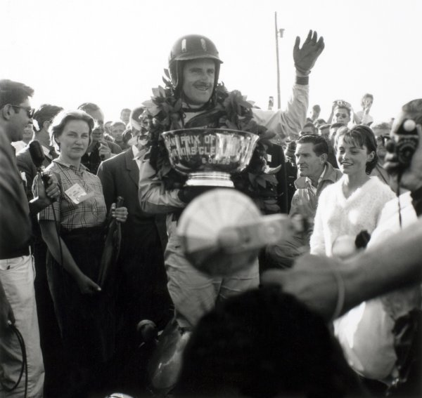 1963 United States Grand Prix.Watkins Glen, New York, USA. 4-6 October 1963.Graham Hill (BRM/Owen Racing Org.) celebrates his 1st position on the podium, portraitWorld Copyright - LAT Photographic.Ref-19774