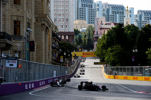 Baku City Circuit, Baku, Azerbaijan. Sunday 19 June 2016. Fernando Alonso, McLaren MP4-31 Honda, leads Felipe Nasr, Sauber C35 Ferrari at the start of the race World Copyright: Sam Bloxham/LAT Photographic ref: Digital Image _SLA3508