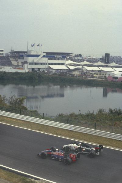 1987 Japanese Grand Prix  Suzuka, Japan. 29th October - 1st November 1987.  Philippe Alliot, Larrousse Lola LC87 Ford, alongside Jonathan Palmer, Tyrrell DG016 Ford.  Ref: 87JAP08. World Copyright: LAT Photographic