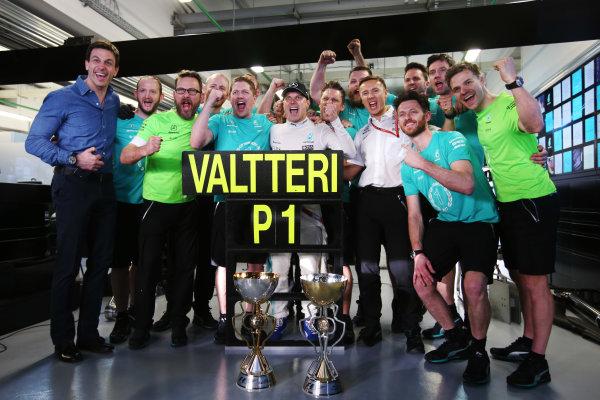 Sochi Autodrom, Sochi, Russia. Sunday 30 April 2017. Valtteri Bottas, Mercedes AMG, 1st Position, celebrates his maiden F1 victory with his team. World Copyright: /LAT Images ref: Digital Image DJ5R9687