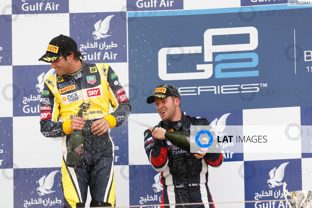 2013 GP2 Series. Round 2.  Bahrain International Circuit, Sakhir, Bahrain. 21st April.  Sunday Race.  Sam Bird (GBR, RUSSIAN TIME) celebrates his victory on the podium with Felipe Nasr (BRA, Carlin). World Copyright: Alastair Staley/GP2 Series Media Service. Ref: _R6T7943
