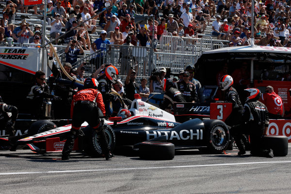 14 July, 2013, Toronto, Ontario, Canada Helio Castroneves pit stop © 2013, Michael L. Levitt LAT Photo USA.