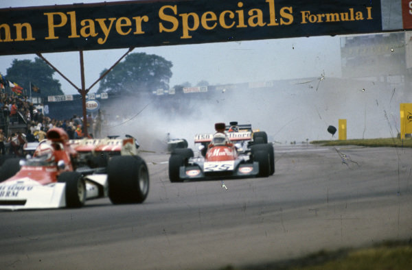 A multi-car accident takes place behind Clay Regazzoni, BRM P160E, 7th, Howden Ganley, Williams IR02 Ford, 9th and Emerson Fittipaldi, Lotus 72E Ford.