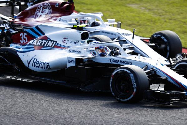 Sergey Sirotkin, Williams FW41, battles with Charles Leclerc, Sauber C37 Ferrari