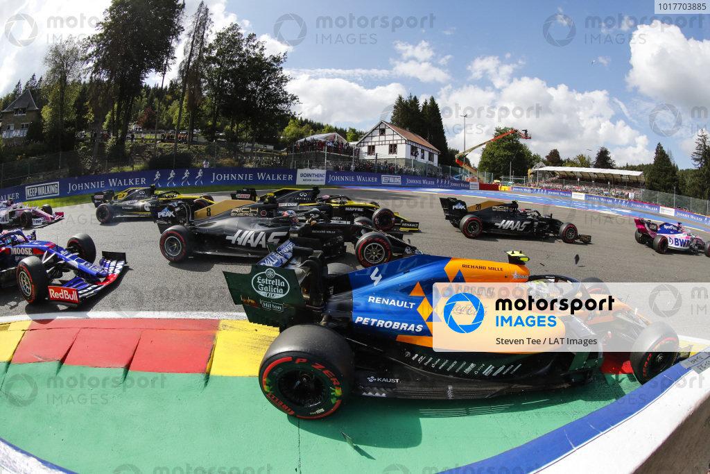 Lando Norris, McLaren MCL34, leads Kevin Magnussen, Haas VF-19 Daniel Ricciardo, Renault R.S.19, Romain Grosjean, Haas VF-19, Nico Hulkenberg, Renault R.S. 19 and Pierre Gasly, Toro Rosso STR14