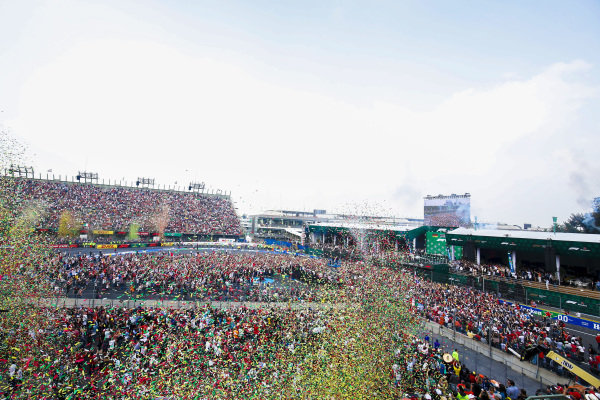 A huge crowd is gathered as confetti falls during the podium ceremony