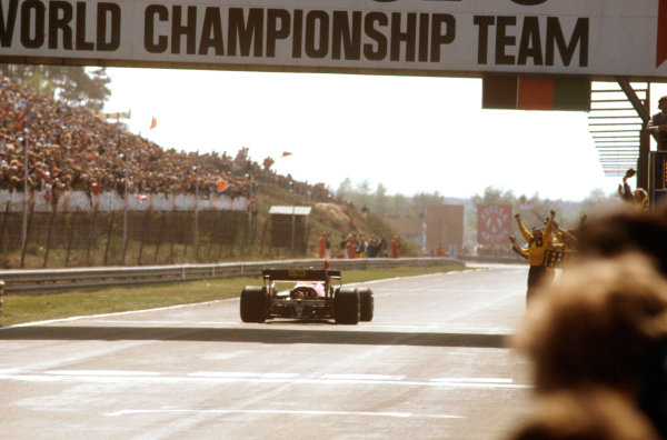 Zolder, Belgium.27-29 April 1984.Michele Alboreto (Ferrari 126C4) punches the air after taking the victory as team collegues celebrate the win on the pit wall.Ref-84 BEL 02.World Copyright - LAT Photographic