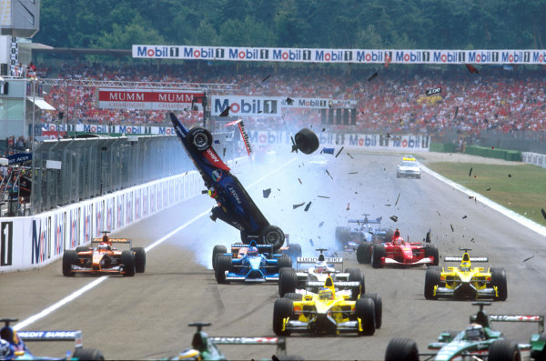 2001 German Grand Prix - Race.Hockenheim, Germany. 29th July 2001.Luciano Burti, Prost Acer AP04, is launched into the air, after crashing into the back of the slowing Ferrari of Michael Schumacher. Start action.World Copyright: Charles Coates/LAT Photographic.ref: 35mm Image A02